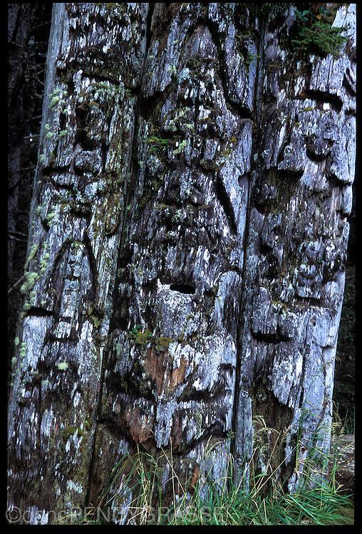 Totems fade into memory in Haida Gwaii, British Columbia, Canada.