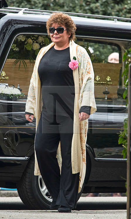 © Licensed to London News Pictures. 18/04/2016. Shirley, UK.  Daughter Emma Corbett arrives at The funeral of comedian, actor, writer Ronnie Corbett, held at St John the Evangelist Church in Shirley near Croydon. Corbett, who was most famous for his comedy sketch show  The Two Ronnies, performed with the late Ronnie Barker, died at the age of 85. Photo credit: Ben Cawthra/LNP