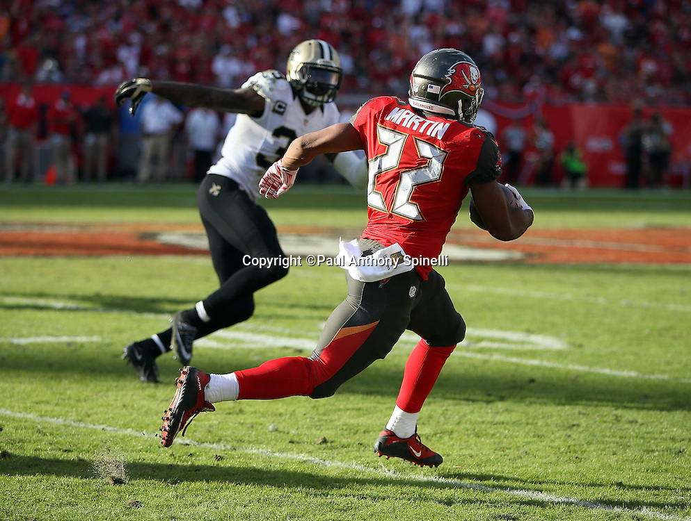 Tampa Bay Buccaneers running back Doug Martin (22) runs for a fourth quarter gain of 24 yards to the Bucs 44 yard line during the 2015 week 14 regular season NFL football game against the New Orleans Saints on Sunday, Dec. 13, 2015 in Tampa, Fla. The Saints won the game 24-17. (©Paul Anthony Spinelli)