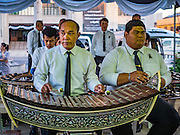 20 JANUARY 2017 - BANGKOK, THAILAND: Traditional Thai musicians perform on the plaza in front of Bangkok's City Hall before a merit making ceremony. Hundreds of municipal workers and civil servants made merit by praying and presenting alms to 89 Buddhist monks Friday to mark 100 days of mourning since the death of revered Bhumibol Adulyadej, the Late King of Thailand. The significance of 89 monks is that the King, who died on October 13, 2016, was a few weeks short of his 89th birthday.       PHOTO BY JACK KURTZ