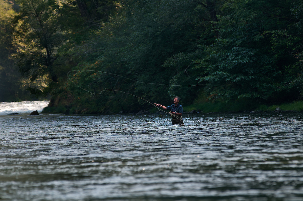 A fly fisherman cast while fishing the North Umpqua River for steelhead.