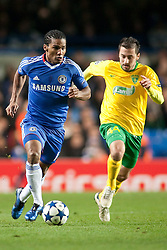 23.11.2010, Stamford Bridge, London, ENG, UEFA CL, Chelsea FC vs MSK Zilina, im Bild Chelsea's midfielder Florent Malouda and MK Zilina's midfielder Admir Vladavic in action during the UEFA Champions League group stage match between Chelsea FC from England and MSK Zilina from Slovakia, played at Stamford Bridge Chelsea London UK, EXPA Pictures © 2010, PhotoCredit: EXPA/ M. Gunn