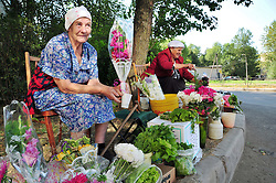 Flowers and fruit for sale at this friendly corner fruit stand opposite the Salt Pier, where river boats moor in St. Petersburg, Russia.