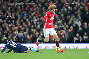 Marouane Fellaini Midfielder of Manchester United gets past Middlesbrough Marten de Roon during the Premier League match between Manchester United and Middlesbrough at Old Trafford, Manchester, England on 31 December 2016. Photo by Phil Duncan.