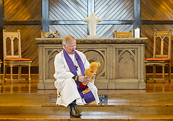 March 17, 2019 - Christchurch, Canterbury, New Zealand - The Rev. Dr. Matthew Jack of Knox Presbyterian Church shows how he spoke to children during Sunday morning services about ''not letting meanness set the agenda'' in the wake of two mosque shootings in the city that left at least 50 people dead. In a brief emotional sermon later, he asked, ''why does the world produce people who hate?'' Jack said he and other faith-based leaders throughout the city scrapped their planned sermons to address Friday's mosque shootings. (Credit Image: © PJ Heller/ZUMA Wire)