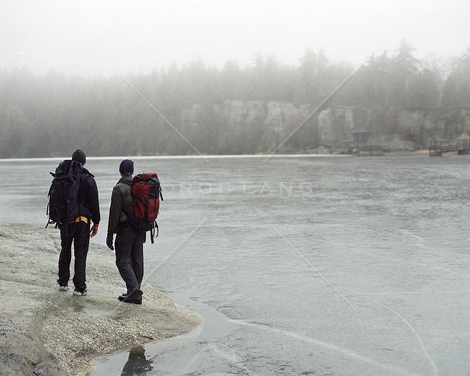 two men standing by a frozen lake in upstate New York