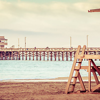 Vintage picture of Newport Pier and lifeguard tower 19. Newport Pier is in Newport Beach, Orange County, Southern California. Photo has a retro vintage 1960s tone.