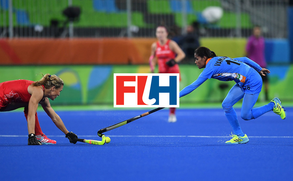 India's Vandana Katariya (R) and Britain's Crista Cullen stretch for the ball during the womens's field hockey India vs Britain match of the Rio 2016 Olympics Games at the Olympic Hockey Centre in Rio de Janeiro on August, 8 2016. / AFP / MANAN VATSYAYANA        (Photo credit should read MANAN VATSYAYANA/AFP/Getty Images)