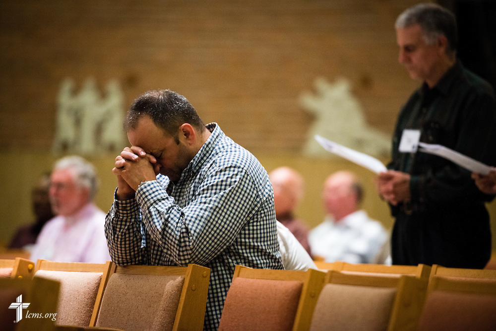 A chaplain prays at evening worship during the LCMS Specialized Pastoral Ministry Educational Event and Retreat at the Mercy Conference and Retreat Center on Wednesday, Oct. 29, 2014, in Frontenac, Mo. LCMS Communications/Erik M. Lunsford