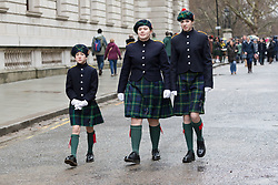 © Licensed to London News Pictures. 20/01/2018. London, UK. Student members of the Pipes and Drums Band from Gordon's School in Surrey arrive to lead the annual parade to the national monument to General Gordon of Khartoum. The school is the only one in the country permitted to march along Whitehall. Students are dressed in their ceremonial Blues uniform and make their way down Whitehall before arriving at the statue of General Gordon for a memorial service to commemorate his death. Photo credit: Vickie Flores/LNP