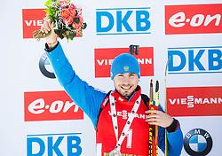 Second placed SHIPULIN Anton (RUS) celebrates during medal ceremony after the Men 12,5 km Pursuit at day 3 of IBU Biathlon World Cup 2014/2015 Pokljuka, on December 20, 2014 in Rudno polje, Pokljuka, Slovenia. Photo by Vid Ponikvar / Sportida