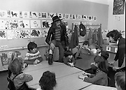 "1982.19.05.1982.05.19.1982.19th May !982.Pat Ingoldsby at CRC ..Pat tells the children a story as teacher Sharon Soley looks on..In preparation for the C.R.C charity ""Jogathon"" Pat Ingoldsby visits the children at the centre. The jogathon would be led by eight major celebrities including Brendan Grace (Bottler) and Rugby international Ciaran Fitzgerald."