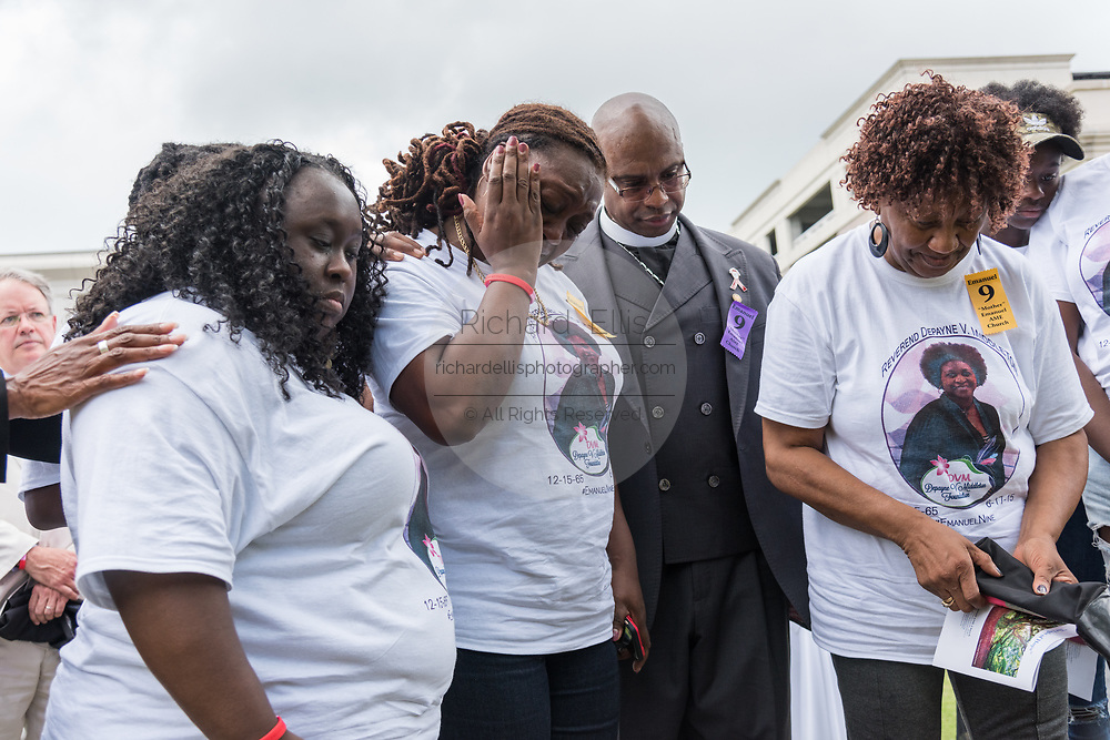Family members of Rev. Depayne Middleton-Doctor, killed in the Mother Emanuel African Methodist Episcopal Church shooting comfort each other during the unveiling of a memorial marker on the 2nd anniversary of the mass shooting June 17, 2017 in Charleston, South Carolina. Nine members of the historic African-American church were gunned down by a white supremacist during bible study on June 17, 2015.
