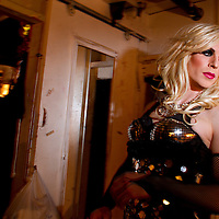 Drag Queen Drag Queen Katya gets ready  for a show at Jacques Cabaret in Bay Village neighborhood of Boston, MA USA on March 25, 2012. Seen in back is an another drag queen, Miss Chris in her dressing room.<br /> Jacques Cabaret (EST: 1931) is the oldest drag queen live cabaret in Boston, MA USA.