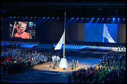 Image licensed to i-Images Picture Agency. 23/07/2014. Glasgow, United Kingdom. The Commonwealth flag is raised  during the opening ceremony of  the Commonwealth Games in Glasgow.. Picture by Andrew Parsons / i-Images