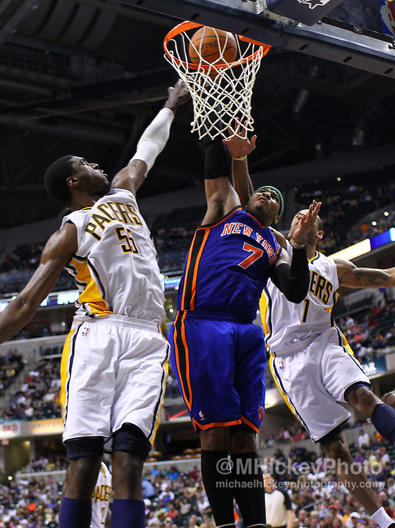 April 10, 2011; Indianapolis, IN, USA; New York Knicks small forward Carmelo Anthony (7) goes up for a shot as Indiana Pacers center Roy Hibbert (55) and Indiana Pacers guard Dahntay Jones (1) defend at Conseco Fieldhouse. Mandatory credit: Michael Hickey-US PRESSWIRE