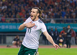 NANNING, CHINA - Thursday, March 22, 2018: Wales' Gareth Bale celebrates scoring the sixth goal, his third to complete his hat-trick, during the opening match of the 2018 Gree China Cup International Football Championship between China and Wales at the Guangxi Sports Centre. (Pic by David Rawcliffe/Propaganda)