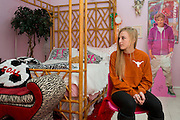 Haley Berg, 15, poses for a photo in her bedroom in Celina, Texas on January 23, 2014. Berg, a freshman at Celina High School, began receiving attention from top collegiate soccer programs when she was 13 and has already committed to the University of Texas. (Cooper Neill / for The New York Times)