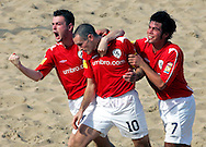 07 December 2006, England's Alex Breingan, captain Jamie O'Rourke and Giancarlo Giancovich celebrate after scoring against Brazil during the first game of the Vodacom Pro Beach Soccer Tour starts at Durban's Bay of Plenty on Thursday. Brazil won the game 10 - 3. Picture: Shayne Robinson, PhotoWire Africa