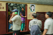 A female passenger looks out of a Women-Only carriage as her train arrives in Mumbai's Chhatrapati Shivaji Terminus.