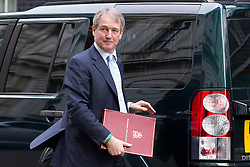 © Licensed to London News Pictures. 18/03/2014. London, UK. The Environment Secretary, Owen Paterson, arrives for a meeting of the British cabinet on Downing Street in London today (18/03/2014). Photo credit: Matt Cetti-Roberts/LNP