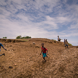 The farther south you go the bumpier the road becomes and the less you see managed agriculture and aid.  Local kids run along the side of tourist vehicles hoping to receive gifts or just have some contact with the strangers.
