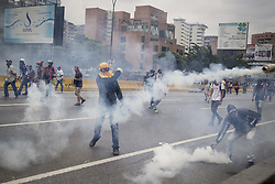 April 19, 2017 - Caracas, Venezuela - Demonstrators clash with the riot police during a protest against Venezuelan President Nicolas Maduro, in Caracas on April 20, 2017. (Credit Image: © Panoramic via ZUMA Press)