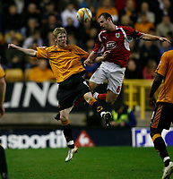 Photo: Steve Bond/Sportsbeat Images.<br /> Wolverhampton Wanderers v Bristol City. Coca Cola Championship. 03/11/2007. Louis Carey  (R) wins the ball in the air