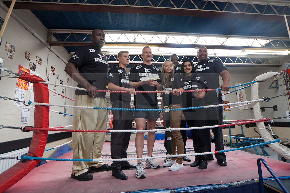 © Licensed to London News Pictures.10/04/2012. London, UK.  The Liberal Democrat mayoral candidate Brian Paddick (centre) poses with former Commonwealth and European heavyweight champion Derek Williams (far left) and twice heavyweight world boxing champion Tim Witherspoon (far right) after he  launched his manifesto at the Pedro Youth Club in Homerton today .Photo credit : James Gourley/LNP