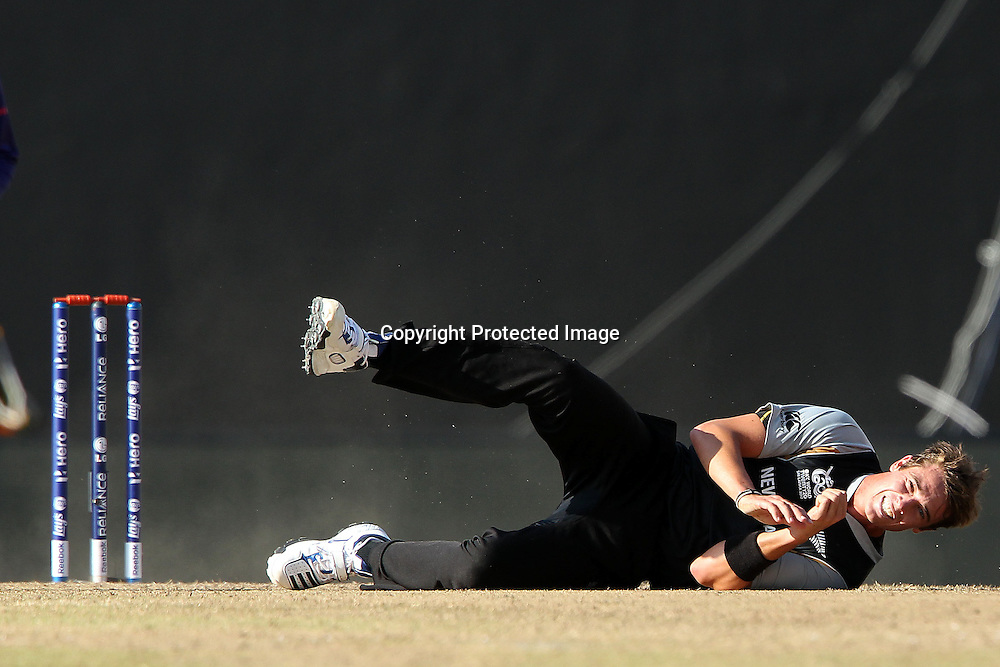 Tim Southee slips after bowling during the ICC World Twenty20 Super Eights match between The West Indies and New Zealand held at the  Pallekele Stadium in Kandy, Sri Lanka on the 1st October 2012<br /> <br /> Photo by Ron Gaunt/SPORTZPICS/PHOTOSPORT
