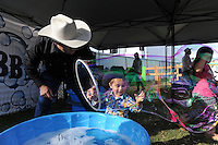 """Mateo Chaidez, 2, makes a bubble big enough to walk in at Thursday's """"Tough Enough To Wear Pink"""" night at the 2014 California Rodeo Salinas."""
