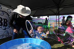 "Mateo Chaidez, 2, makes a bubble big enough to walk in at Thursday's ""Tough Enough To Wear Pink"" night at the 2014 California Rodeo Salinas."