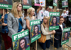 © London News Pictures. 05/10/2013.  London, UK. Georgie Harris (far left), sister of  imprisoned Greenpeace activist Alex Harris holding a placard showing her sisters face with other friends and family of Greenpeace activists.  Supporters of Greenpeace stage a demonstration outside the Russian Embassy in London to protest against the arrest of 30 Greenpeace activists, known as the 'Arctic 30' who charged with piracy by a Russian court, following a peaceful protest against Arctic oil drilling at an oil platform in the Pechora Sea. Photo credit Ben Cawthra/LNP