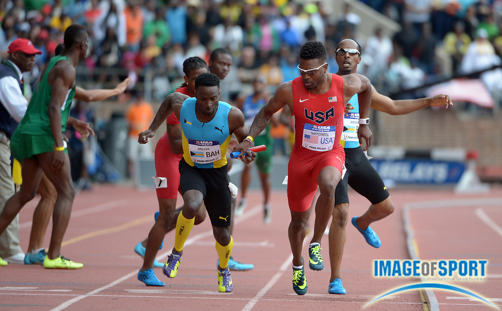 Apr 26, 2014; Philadelphia, PA, USA; Manteo Mitchell (second from right) of the United States drops the baton the anchor leg on the handoff from David Verburg as Chris Brown of the Bahamas (right) hands off to Ramon Miller  in the 120th Penn Relays at Franklin Field. The Bahamas won in 3:00.78.