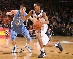 Virginia guard Mustapha Farrakhan (2) is guarded by North Carolina guard Bobby Frasor (4).  The the #5 ranked North Carolina Tar Heels defeated the Virginia Cavaliers 83-61 in NCAA Basketball at the John Paul Jones Arena on the Grounds of the University of Virginia in Charlottesville, VA on January 15, 2009.