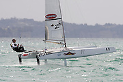Nathan Outteridge (AUS1004) rounds the top mark in race four of the A Class World championships regatta being sailed at Takapuna in Auckland. 12/2/2014