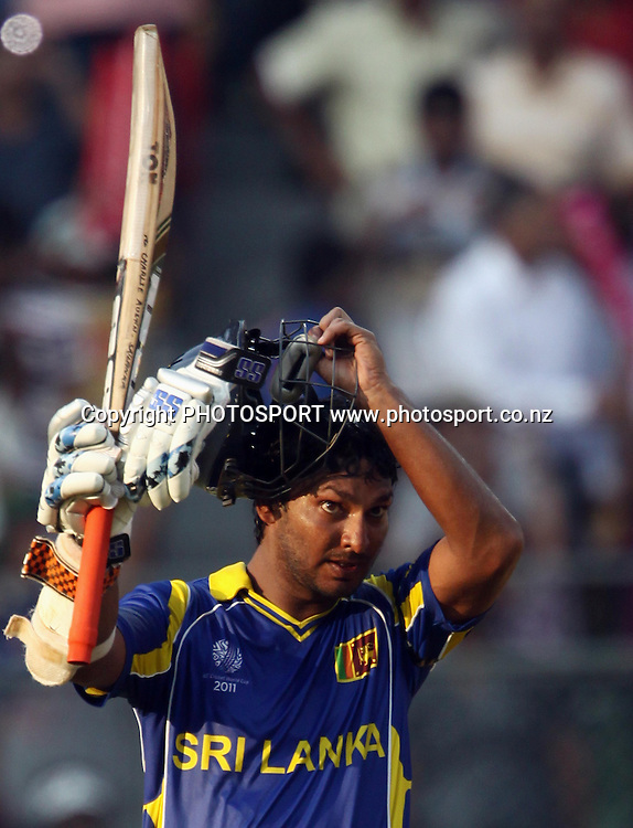 Sri Lankan captain Kumar Sangakkara raises his bat as he celebrates after scoring a century (100 runs) against New Zealand  During the ICC Cricket World Cup - 38th Match, Group A Sri Lanka vs New Zealand  Played at Wankhede Stadium, Mumbai (neutral venue) 18 March 2011 - day/night (50-over match)