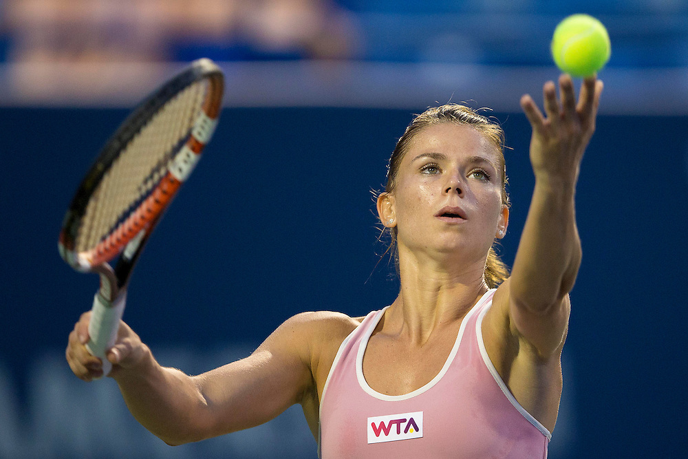 August 21, 2014, New Haven, CT:<br /> Camila Giorgi serves during a match against Garbine Muguruza on day seven of the 2014 Connecticut Open at the Yale University Tennis Center in New Haven, Connecticut Thursday, August 21, 2014.<br /> (Photo by Billie Weiss/Connecticut Open)