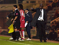 Photo: Daniel Hambury.<br />Peterborough United v Swindon Town. LDV Vans Trophy. 22/11/2005.<br />Swindon's manager Iffy Onuora gives out the orders.