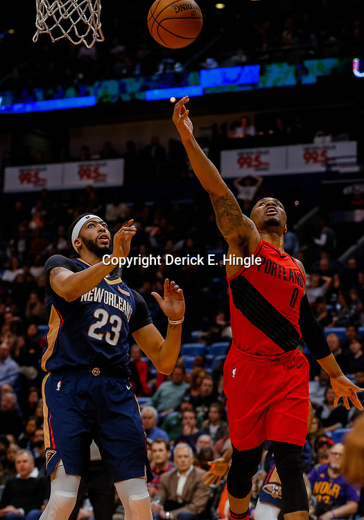 Jan 12, 2018; New Orleans, LA, USA; Portland Trail Blazers guard Damian Lillard (0) shoots over New Orleans Pelicans forward Anthony Davis (23) during the second half at the Smoothie King Center. The Pelicans defeated the Trail Blazers 119-113. Mandatory Credit: Derick E. Hingle-USA TODAY Sports