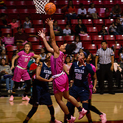 10 February 2018: The San Diego State Aztecs women's basketball team hosts Nevada on Play4Kay day at Viejas Arena. San Diego State Aztecs guard Te'a Adams (5) attempts a lay up while being defended by Nevada Wolf Pack forwards Terae Briggs (11) and  AJ Cephas (32) in the first half. <br /> More game action at www.sdsuaztecphotos.com