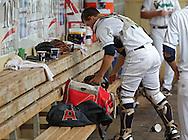 Kernels catcher Abel Baker (11) grabs his gear between innings during the game between the Clinton LumberKings and the Cedar Rapids Kernels at Veterans Memorial Stadium in Cedar Rapids on Monday, September 3, 2012.