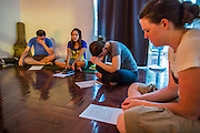 01 APRIL 2013 - BANGKOK, THAILAND:   Prayer before the Hupes go out to work with the street children in the Nana red light district, Left to Right, Tim Hupe, Naamfon Boonlab, their Thai colleague, Amy Hupe and Molly Evans.    PHOTO BY JACK KURTZ