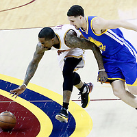 08 June 2016: Cleveland Cavaliers guard J.R. Smith (5) vies for the loose ball with Golden State Warriors guard Klay Thompson (11) during the Cleveland Cavaliers 120-90 victory over the Golden State Warriors, during Game Three of the 2016 NBA Finals at the Quicken Loans Arena, Cleveland, Ohio, USA.