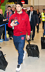 Luis Suarez of FC Barcelona arrives at Manchester Airport with the squad ahead of the UEFA Champions League tie against Manchester City - Photo mandatory by-line: Matt McNulty/JMP - Mobile: 07966 386802 - 23/02/2015 - SPORT - Football - Manchester - Manchester Airport