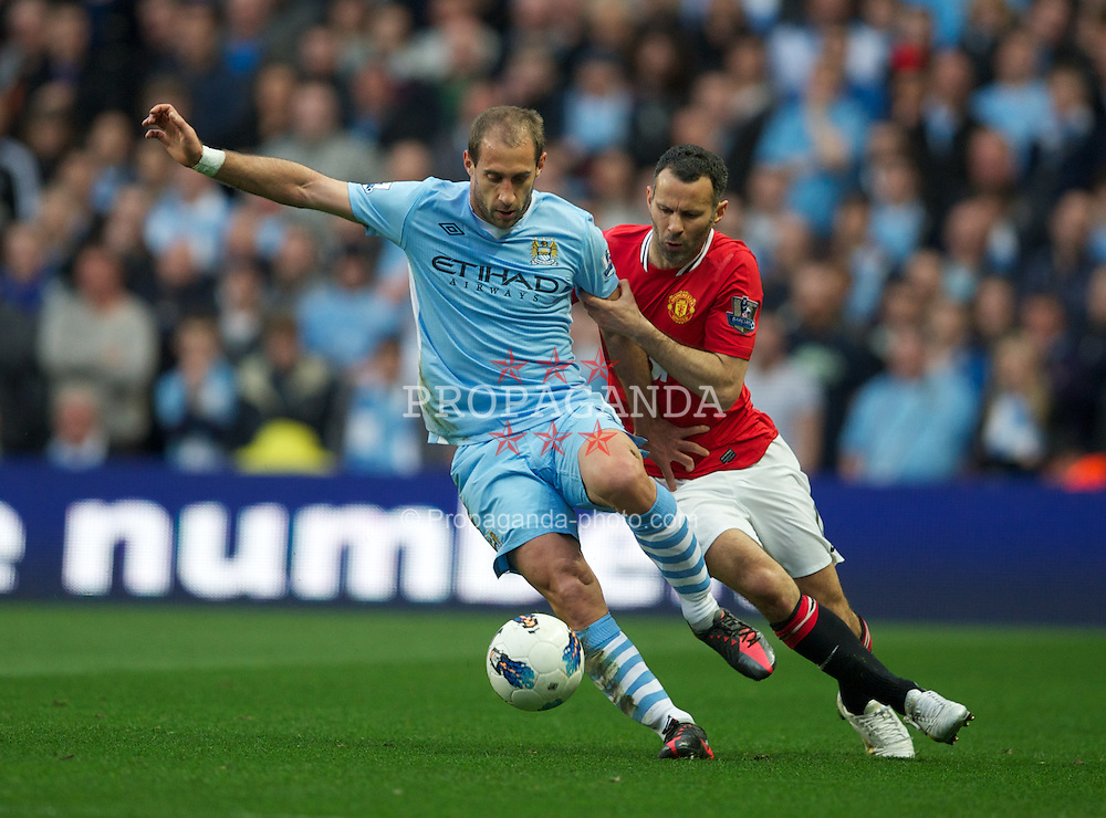 MANCHESTER, ENGLAND - Monday, April 30, 2012: Manchester City's Pablo Zabaleta in action against Manchester United's Ryan Giggs during the Premiership match at the City of Manchester Stadium. (Pic by Chris Brunskill/Propaganda)