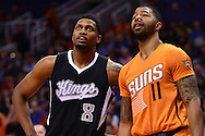 Nov 7, 2014; Phoenix, AZ, USA; Sacramento Kings forward Rudy Gay (8) and Phoenix Suns forward Markieff Morris (11) talk at US Airways Center. The Kings won 114-112 in double overtime. Mandatory Credit: Jennifer Stewart-USA TODAY Sports