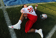 Archer's Dillon Bliss (20) stretches on the sideline prior to Friday's football game between the Peachtree Ridge Lions and the Archer Tigers at Peachtree Ridge High School in Suwanee. (Staff Photo: David Welker)
