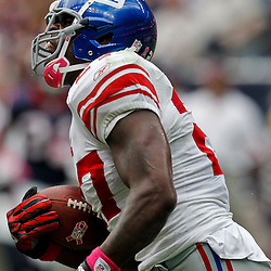 October 10, 2010; Houston, TX USA; New York Giants running back Brandon Jacobs (27) celebrates a touchdown run against the Houston Texans during the first half at Reliant Stadium. Mandatory Credit: Derick E. Hingle
