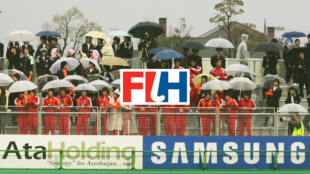 Kakamigahara (Japan): The rain didn't dampen the spirits of these local fans during the match  between Japan and Germany in the Olympic Hockey Qualifier at Gifu Perfectural Green Stadium at Kakamigahara on 10 April 2008. Germany beat Japan 4-0.  <br /> Photo: GNN/ Vino John